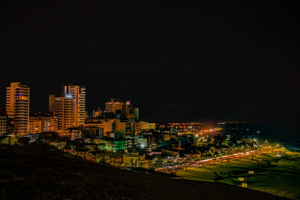 city with high rise buildings during night time