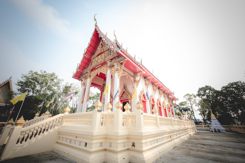 red and white temple during daytime