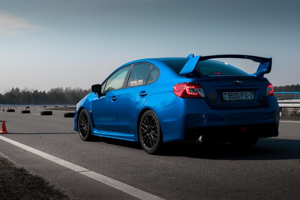 blue subaru on a race track