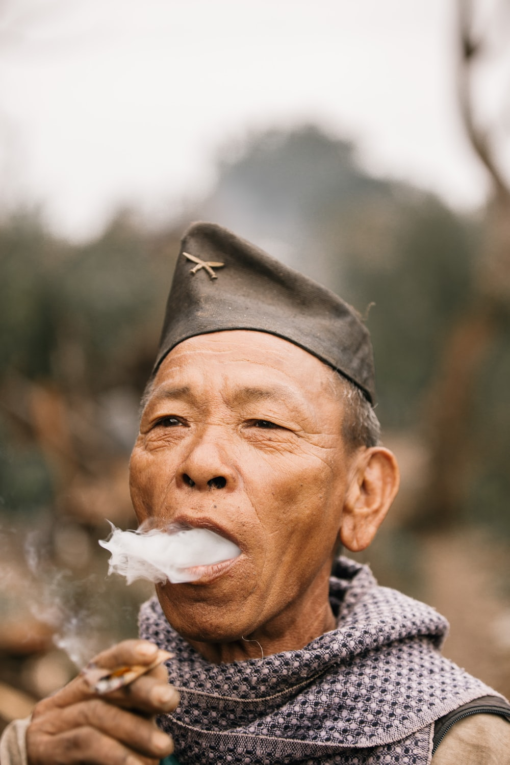 man in black hat with white powder on his mouth