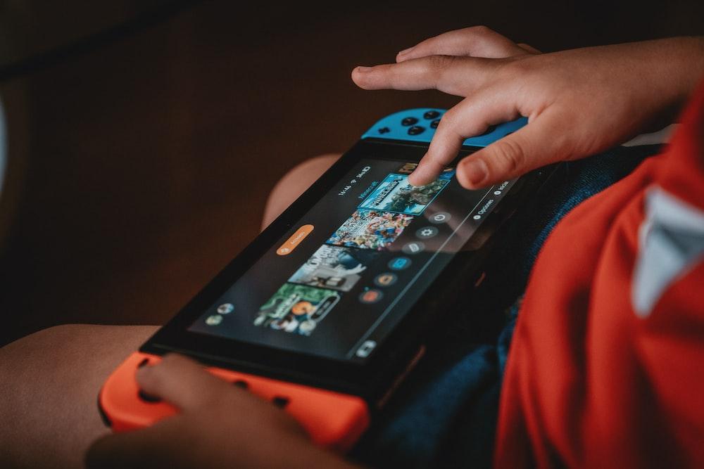 person playing nintendo game boy