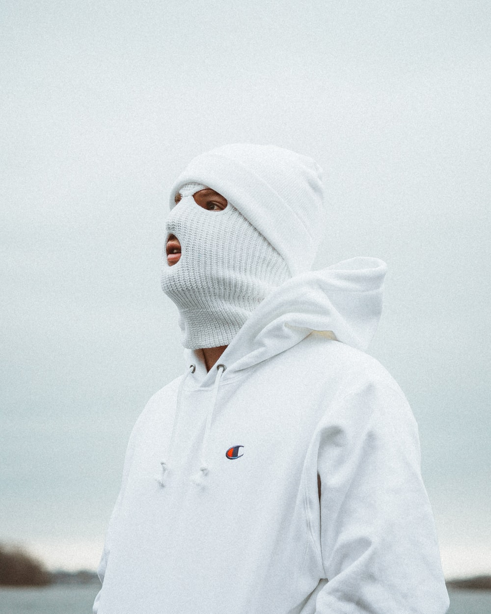 person in white hoodie wearing white knit cap