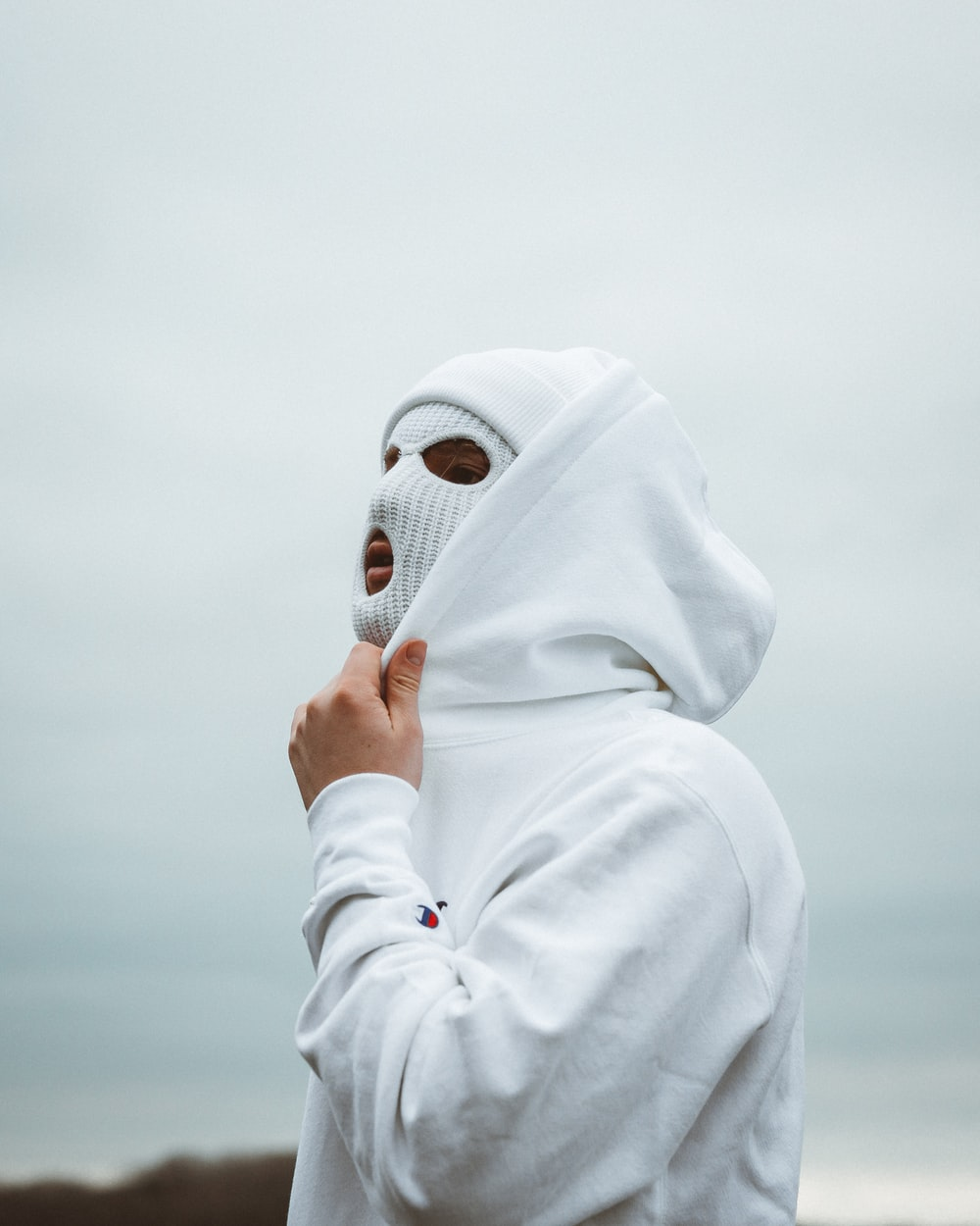 woman in white hijab covering her face with white hijab
