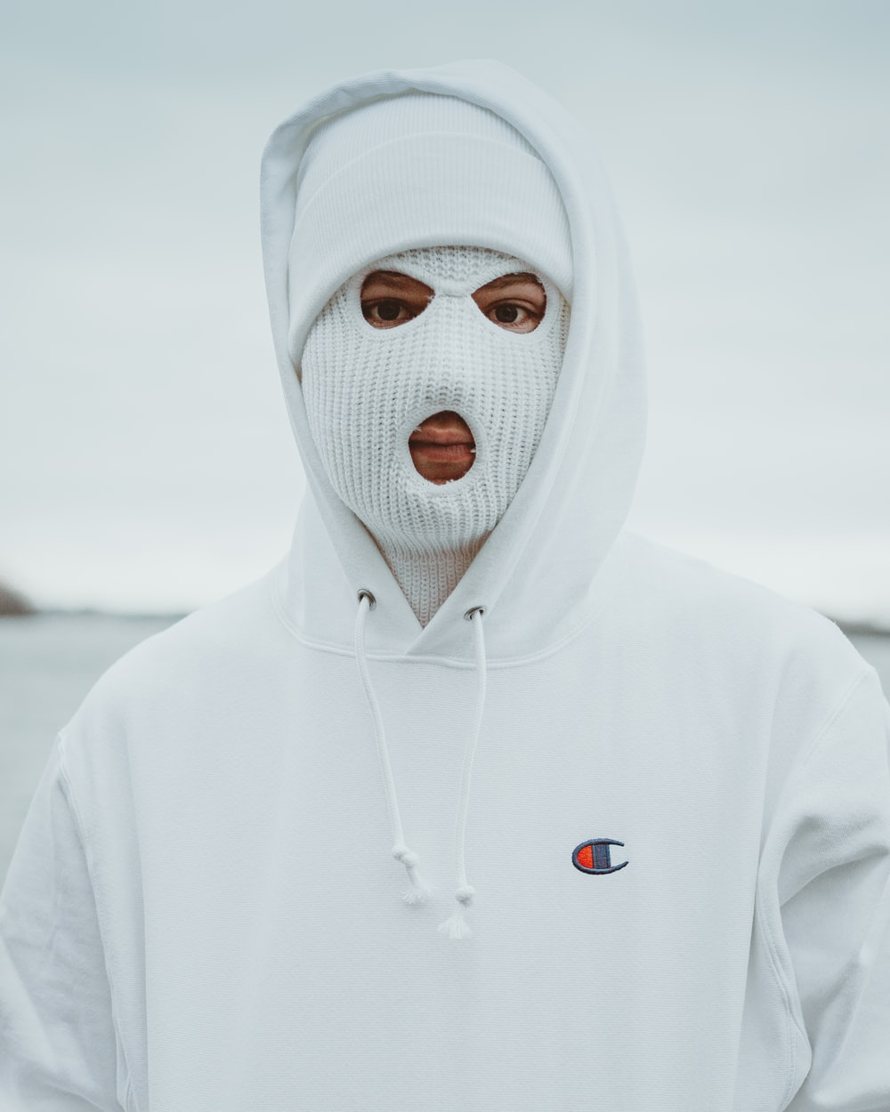 person in white hoodie with white mask