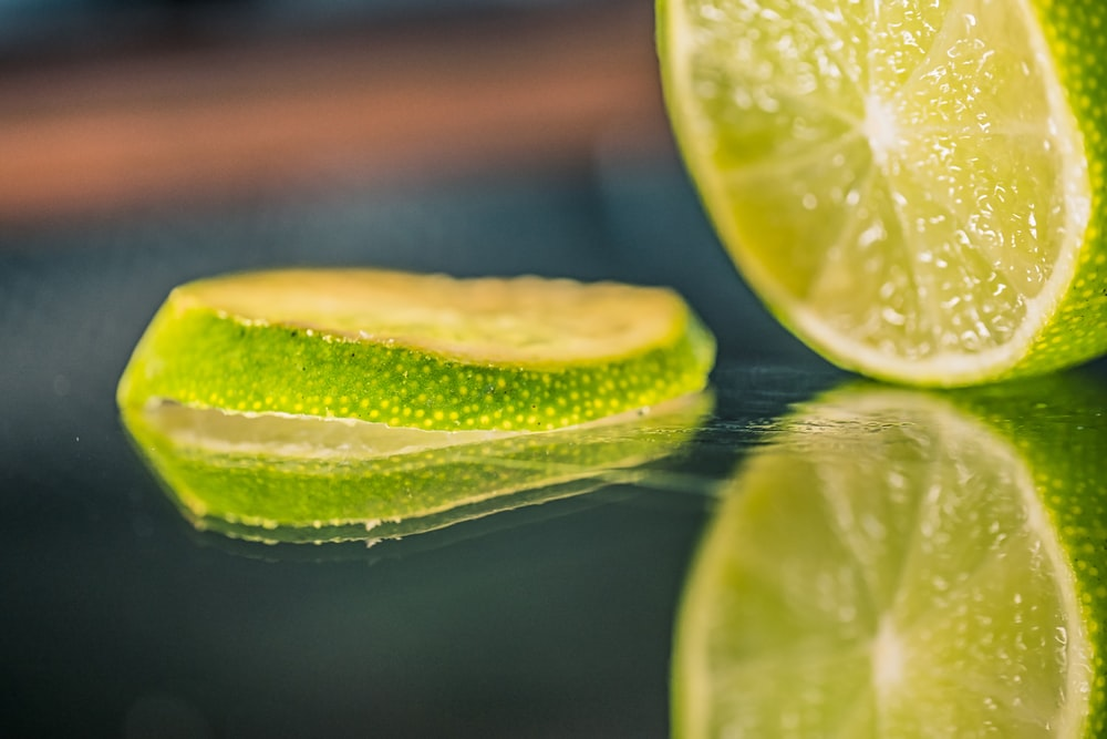 green lemon on water during daytime
