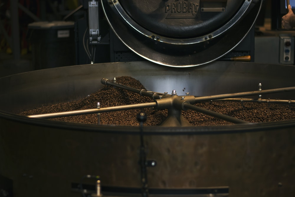 stainless steel and black round machine