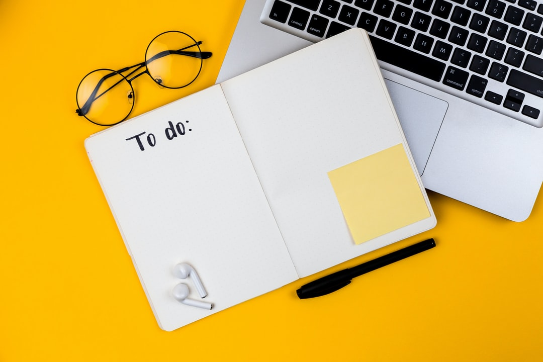 Home office desk workspace with laptop on yellow background. Flat lay, top view girl boss work business concept. Work at home concept on coronavirus quarantine