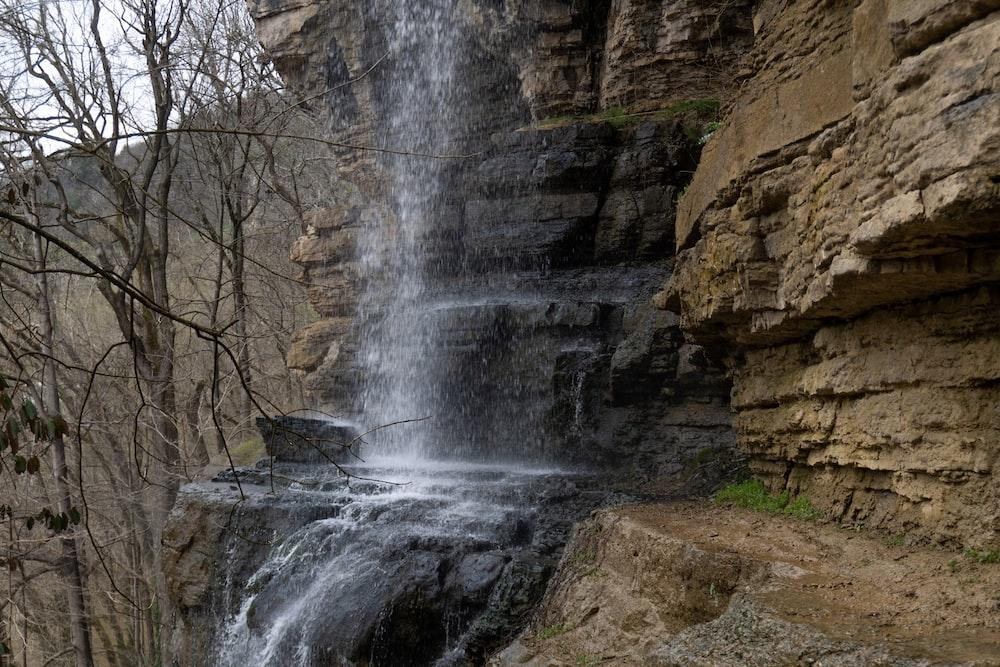 waterfalls in rocky mountain during daytime