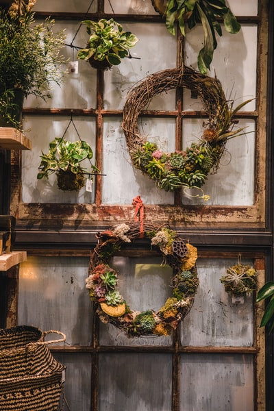 green and brown wreath on window