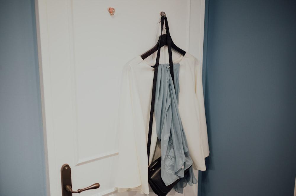 white coat hanged on black clothes hanger