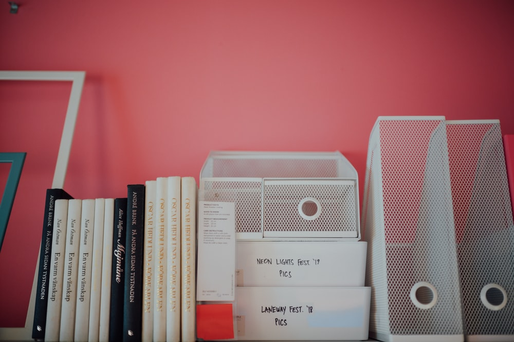 white and gray speaker on books