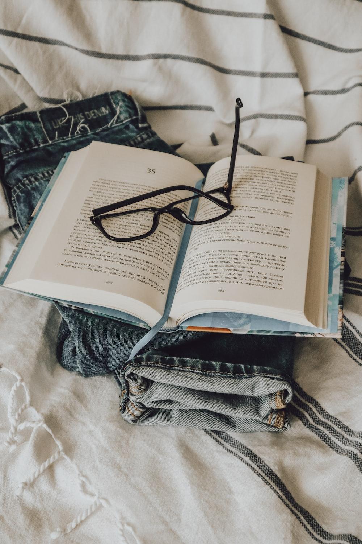black framed eyeglasses on book page