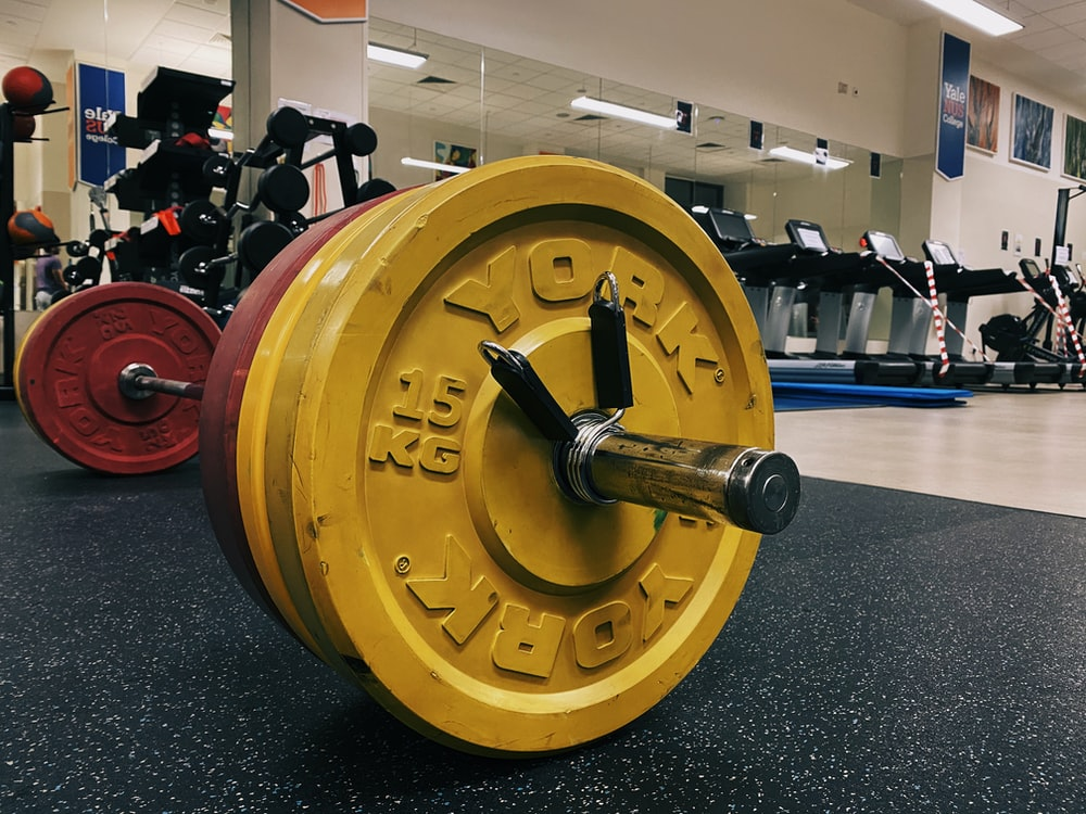 yellow and black dumbbell on black table