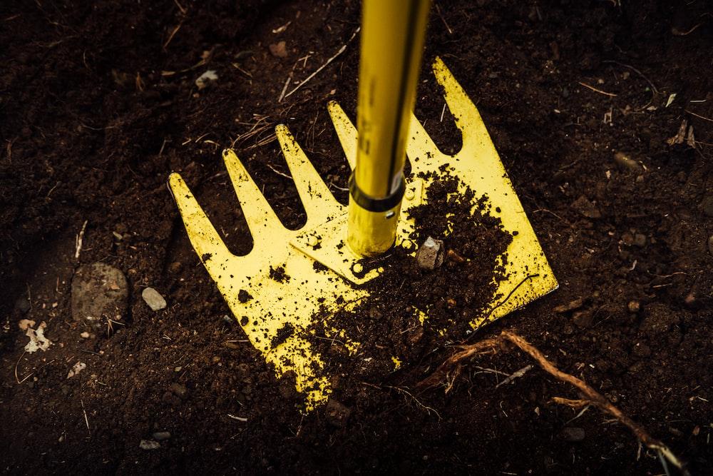 yellow metal pipe on brown soil