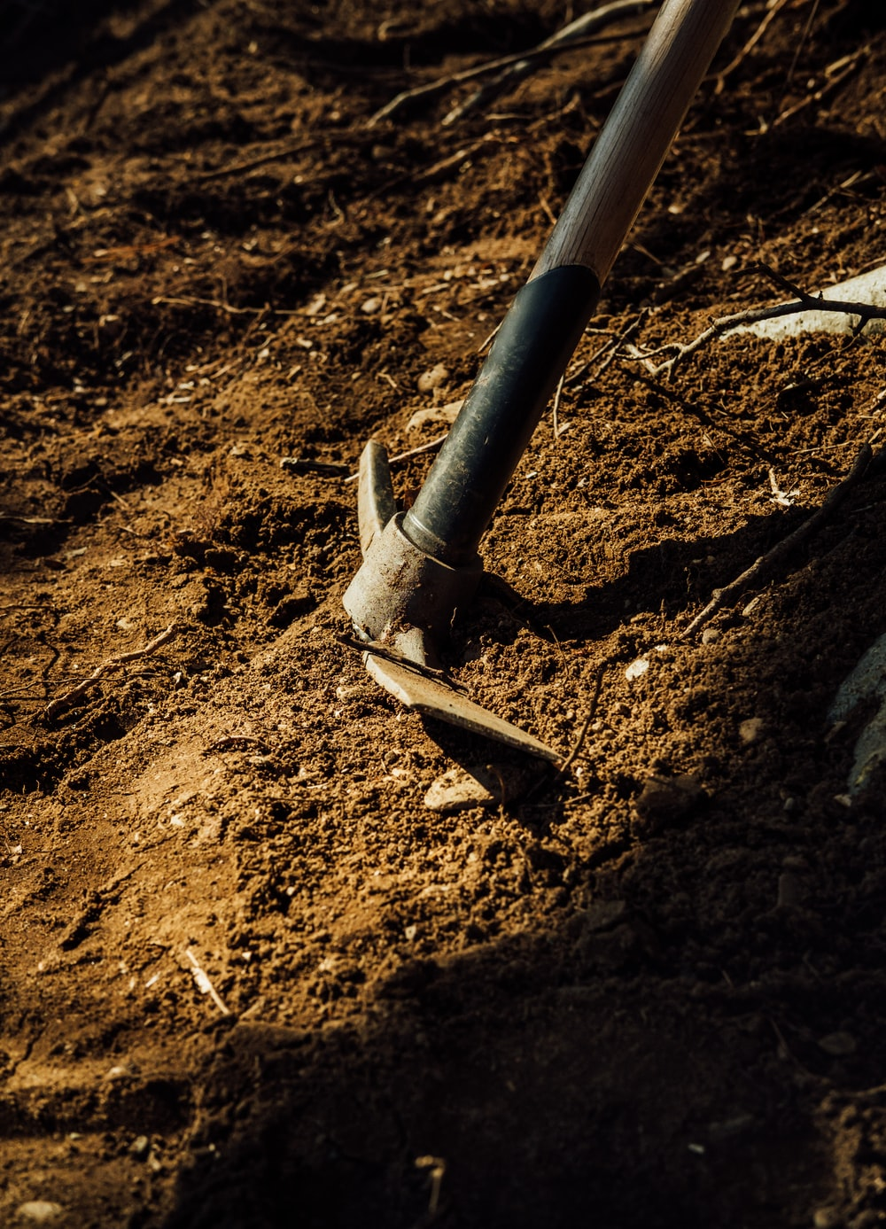 gray metal pipe on brown soil