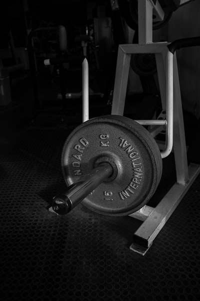 black and gray dumbbell on black textile