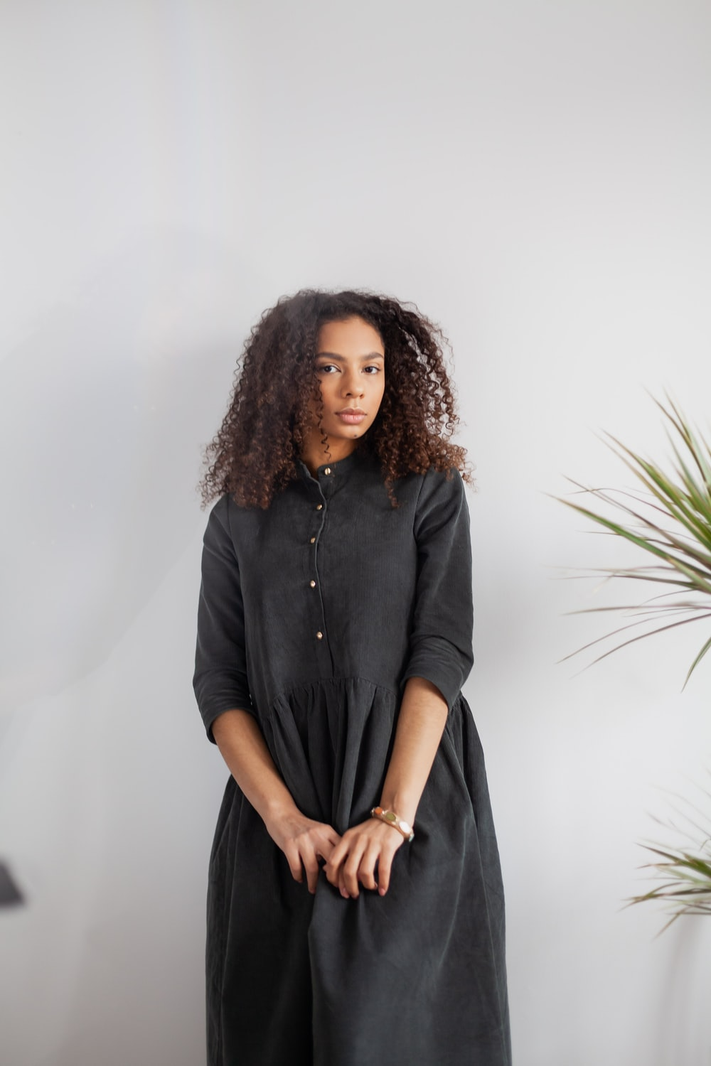 woman in black button up long sleeve shirt