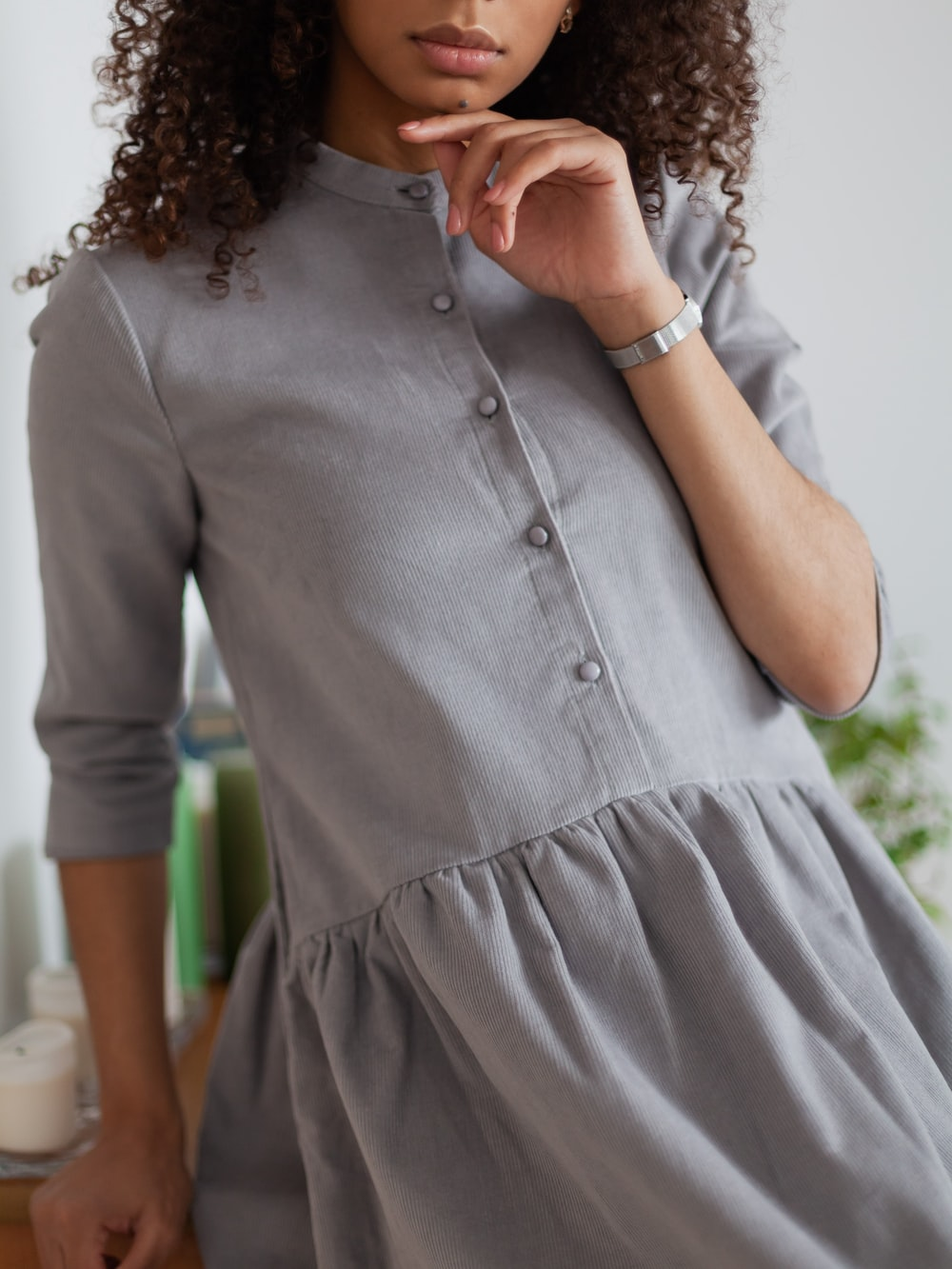 woman in gray button up long sleeve shirt
