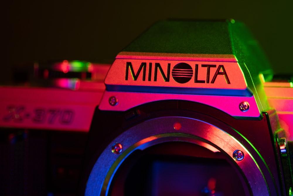 black and red nikon camera