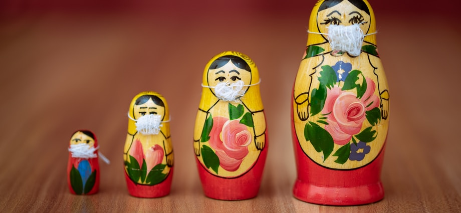 two red and yellow owl ceramic figurines