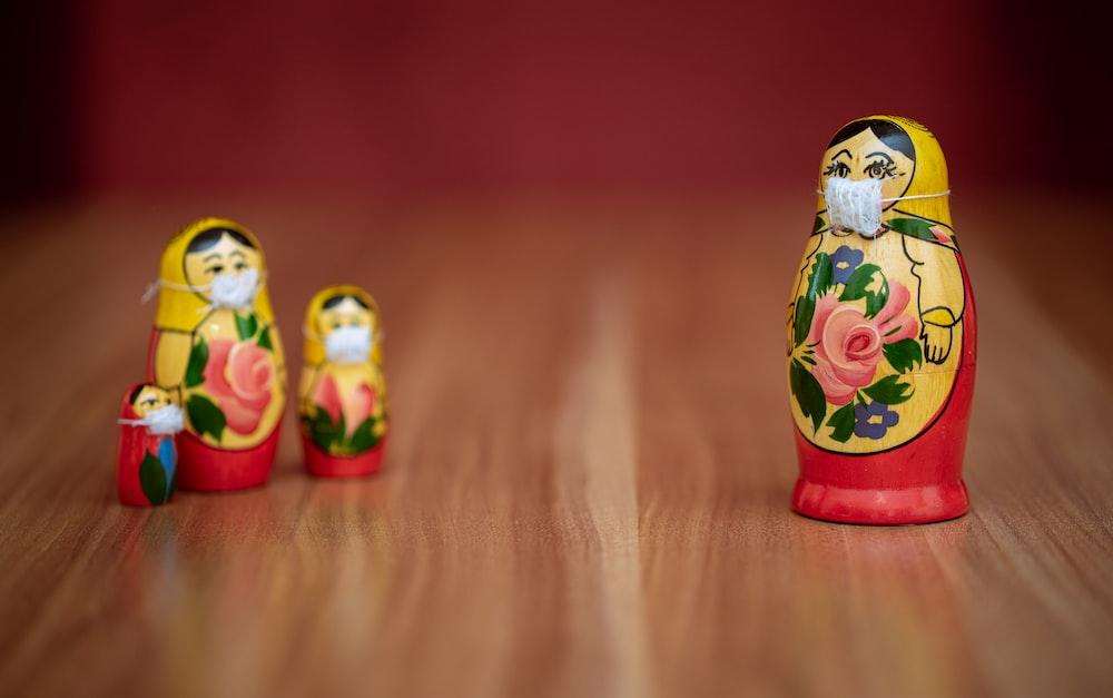 white red and yellow ceramic owl figurine