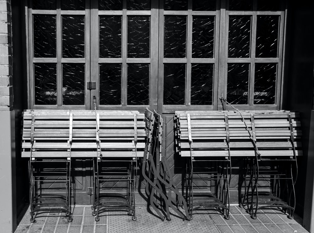 grayscale photo of chairs and tables