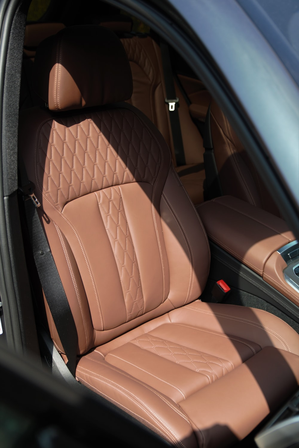 brown leather car seat in car