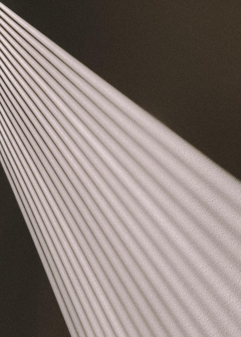 white and black striped textile