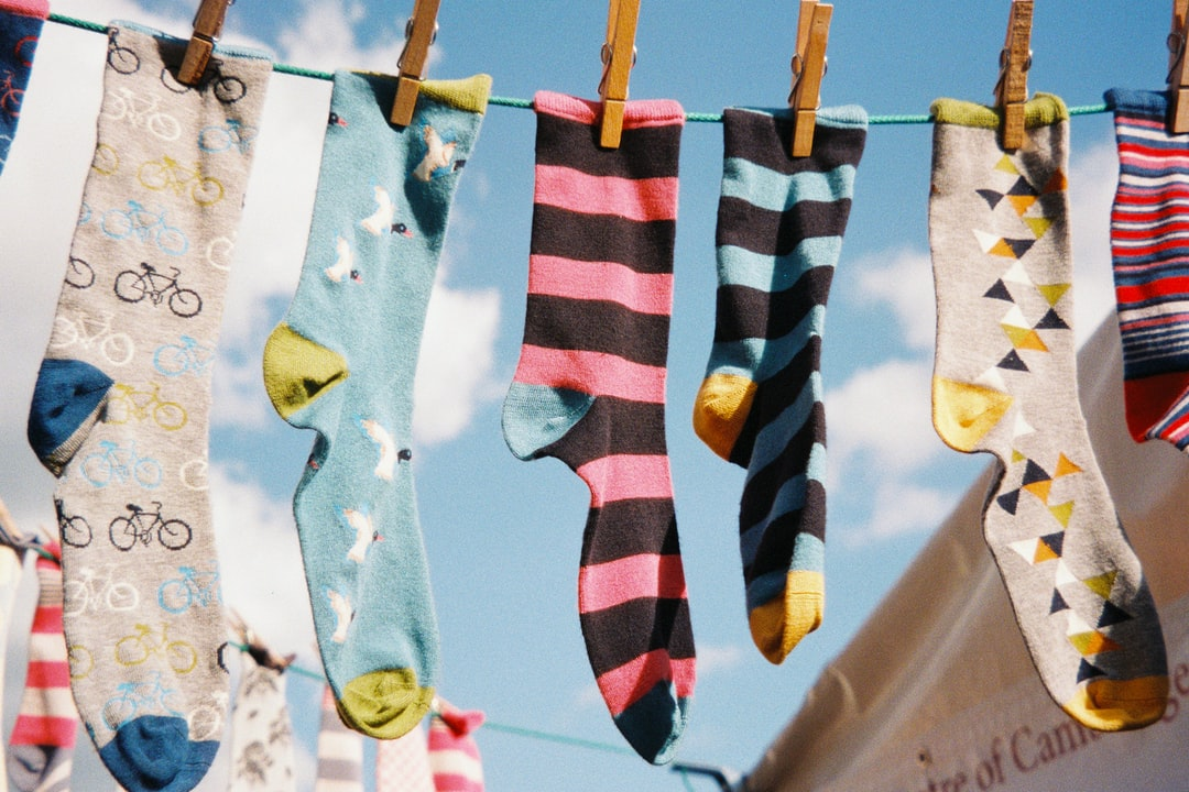 A row of different socks pegged on a line. Shot on film.