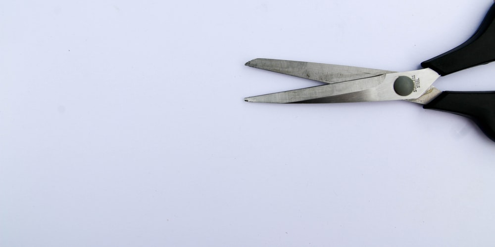silver fork and knife on white surface