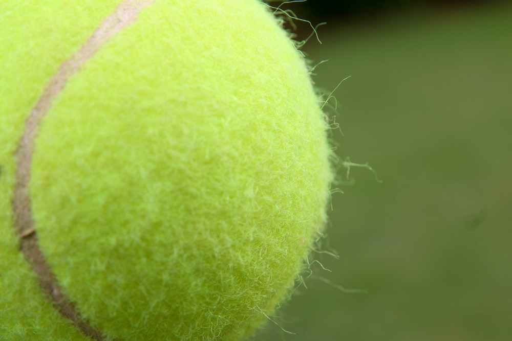 green tennis ball in close up photography