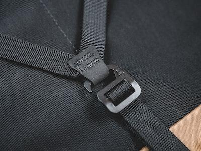 silver belt buckle on black textile