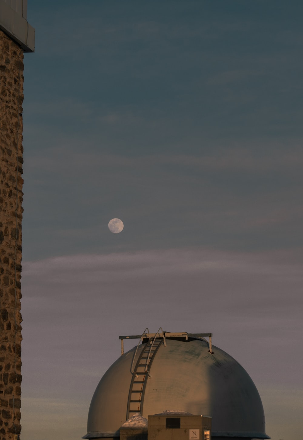 full moon over brown concrete building