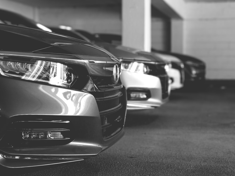 A row of used cars for sale at a dealership