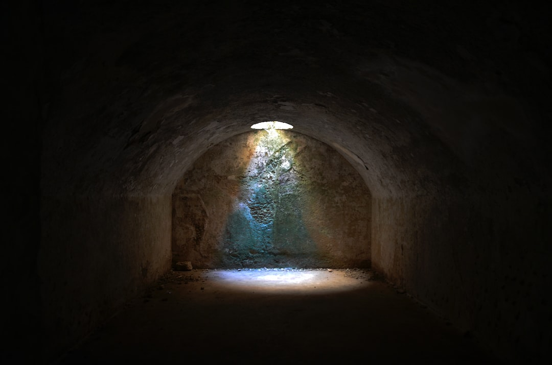 A circle of light illuminating a cellar.