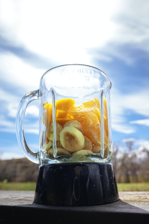 clear glass mug with black liquid inside