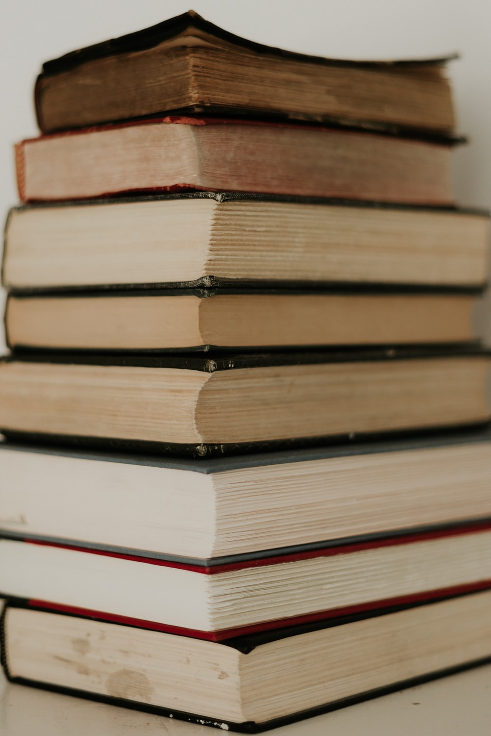 stack of books on blue table