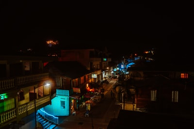 people walking on street during night time belize teams background