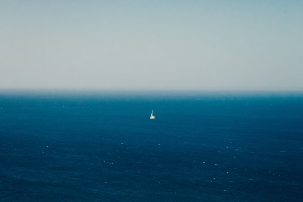 white sailboat on blue sea during daytime
