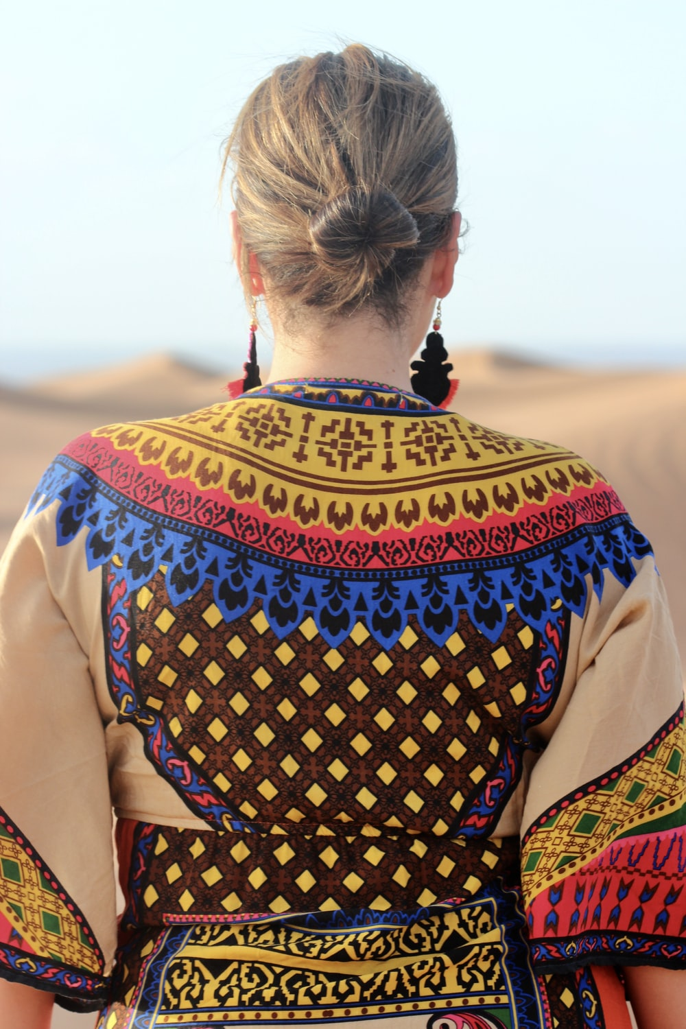 woman in brown and black tribal print shirt