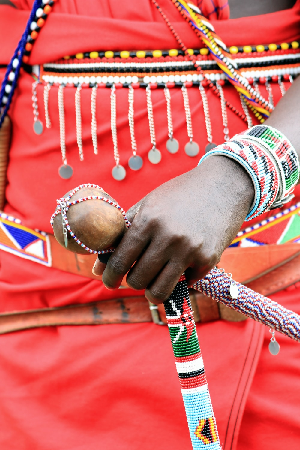 person wearing red white and blue bracelets
