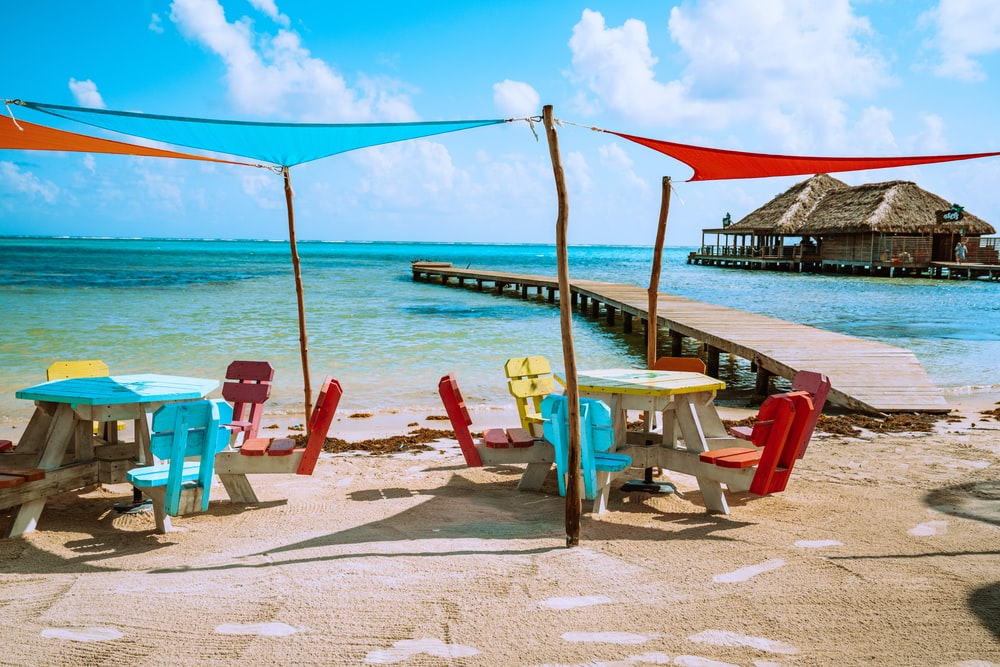 brown wooden beach lounge chairs on beach during daytime