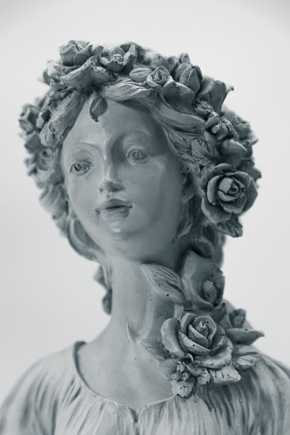 womans face with white flower headdress