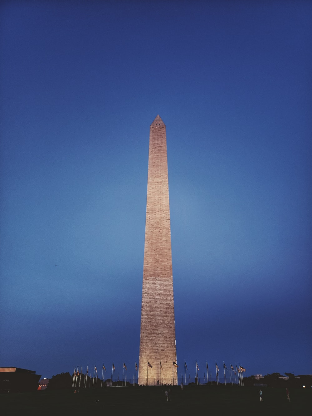brown concrete tower under blue sky