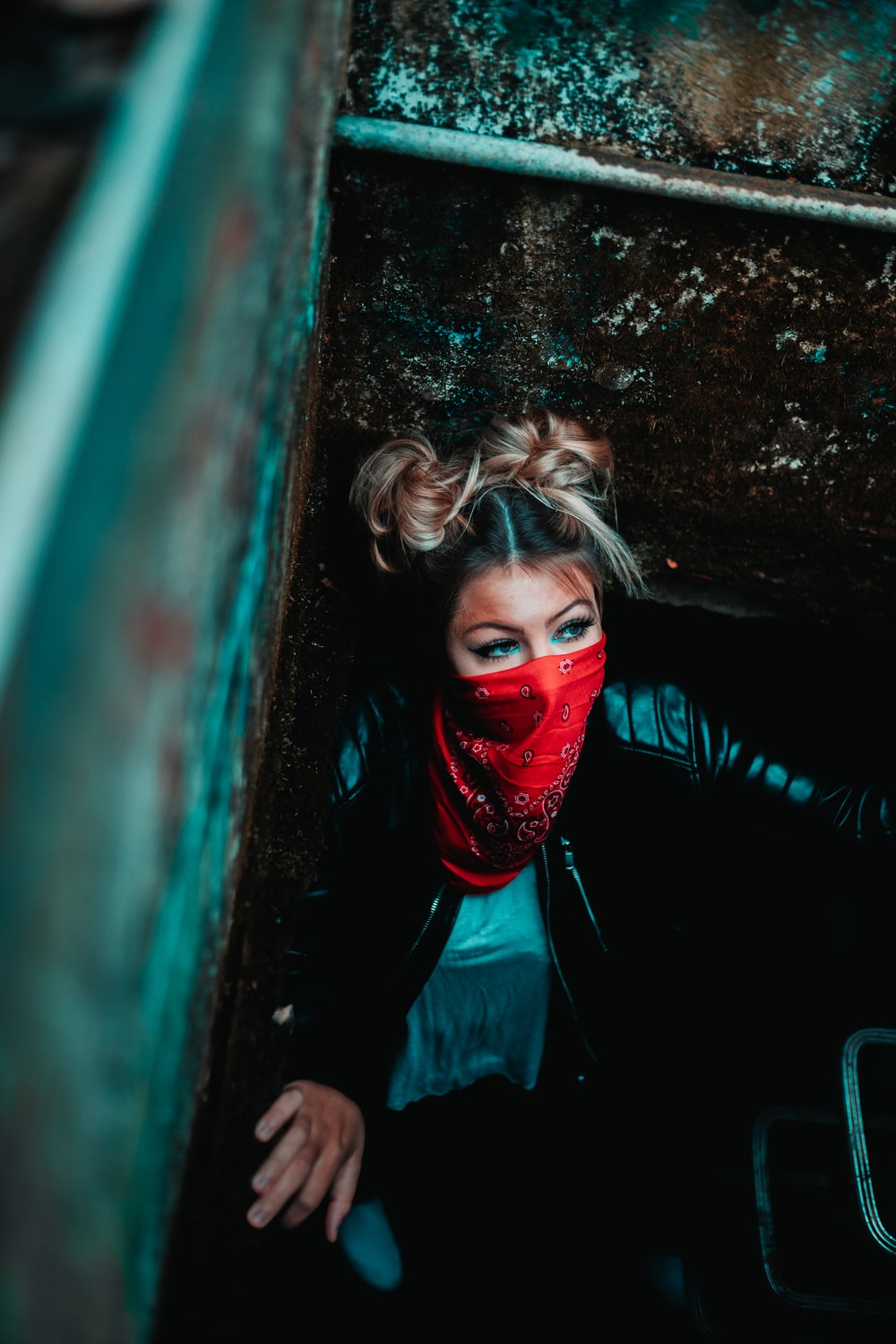 woman in red face mask and black jacket