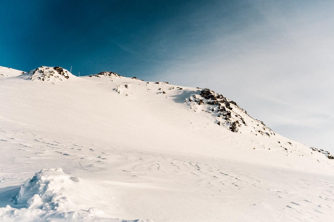 Mountain snow, Snow, Mountainside, blue-sky, no footprints, clean, minimal.