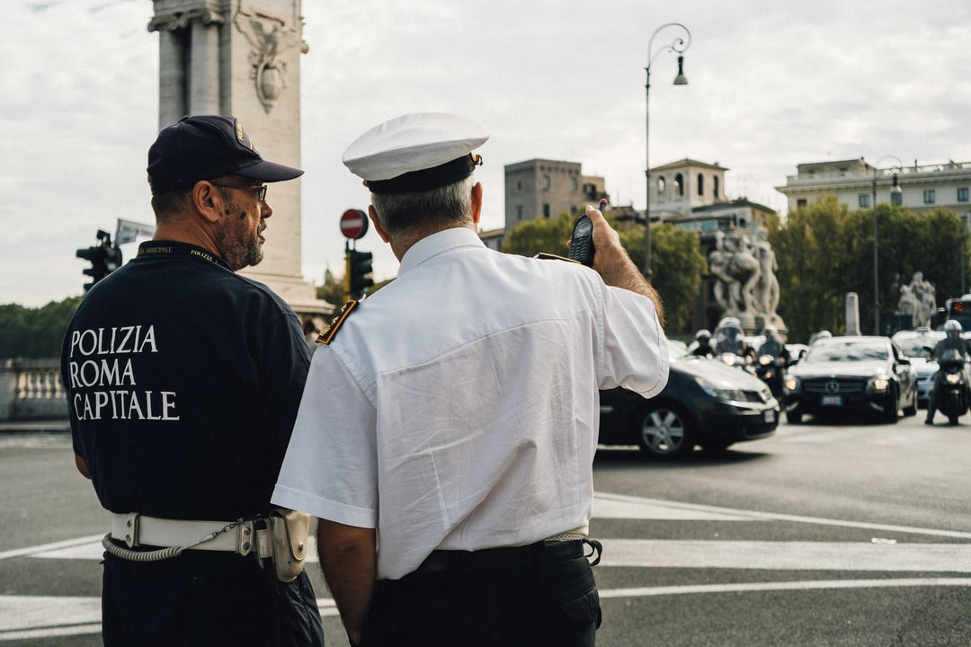 Polizia Roma Capitale, Police Giving Directions and Having A Conversation. Traffic. Rome, Ital. - unsplash
