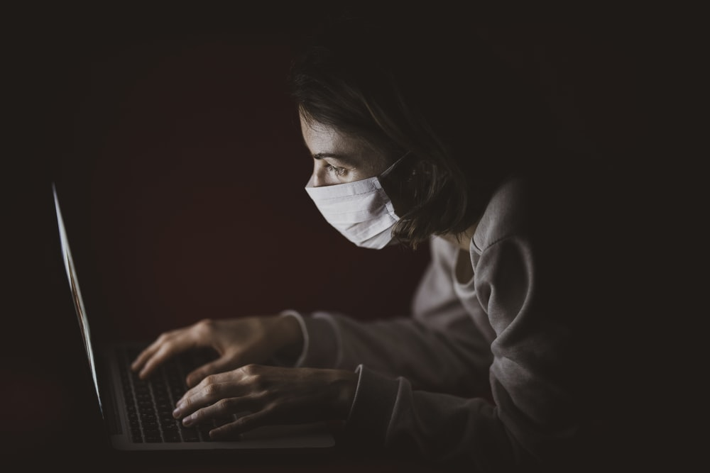 woman in black long sleeve shirt using laptop computer