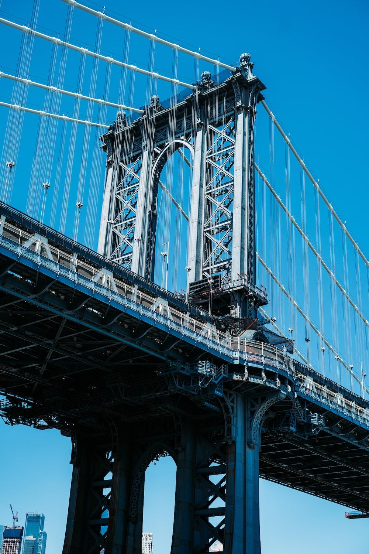 grayscale photo of bridge during daytime