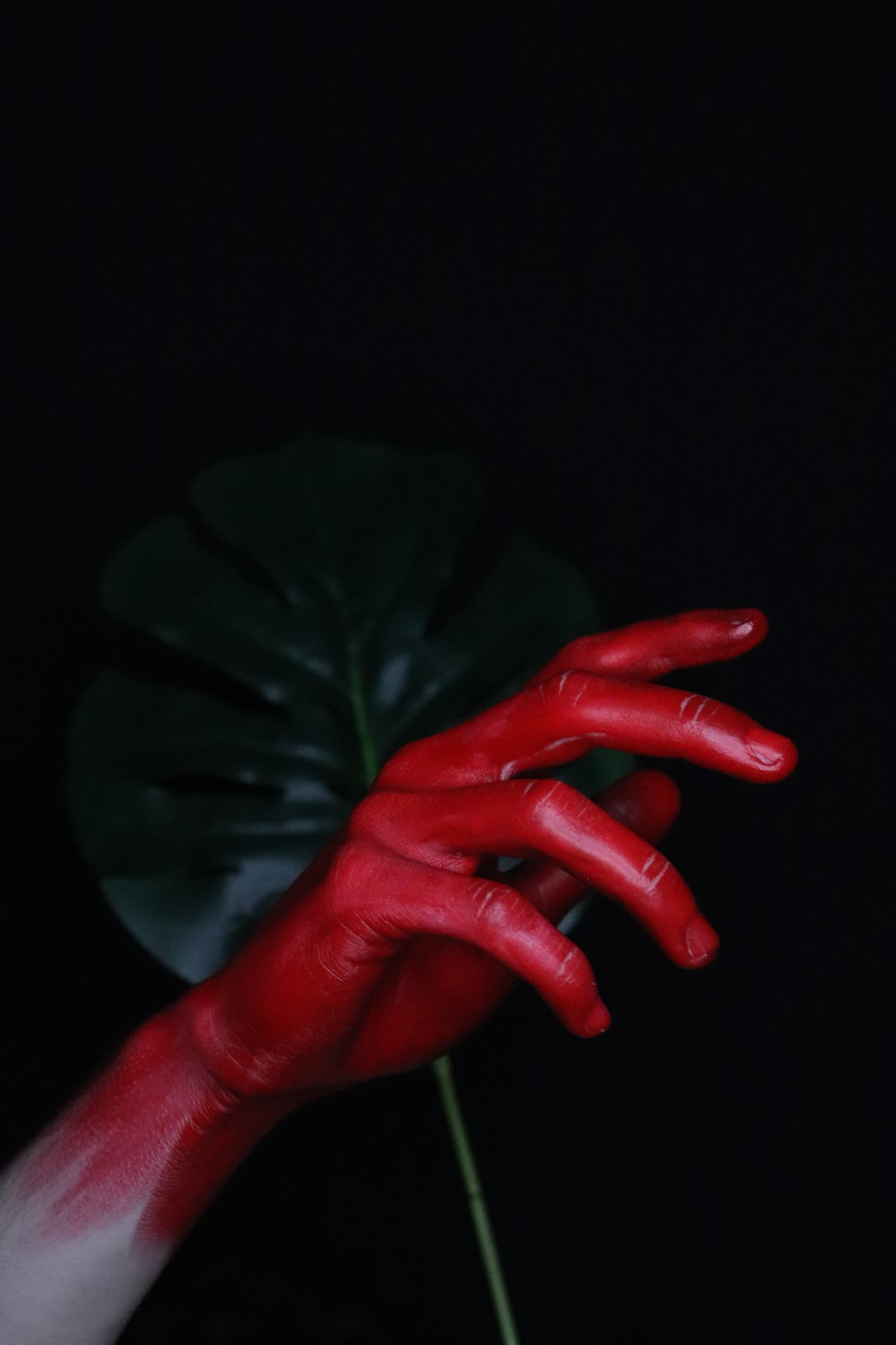 persons left hand with red manicure
